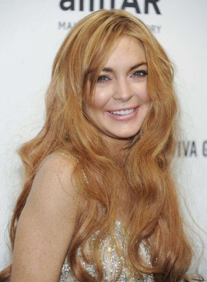 FILE - In this Feb. 6, 2013 file photo, Lindsay Lohan attends amfAR's New York gala at Cipriani Wall Street in New York. Lohan is due back in court on Monday March 18, 2013 for a hearing that will lay out when her trial will begin on misdemeanor charges she lied to police and was driving recklessly when her sports car crashed in June 2012. Lohan's trial is scheduled to begin this week, but her attorney has previously sought a delay. (Photo by Evan Agostini/Invision/AP, File)