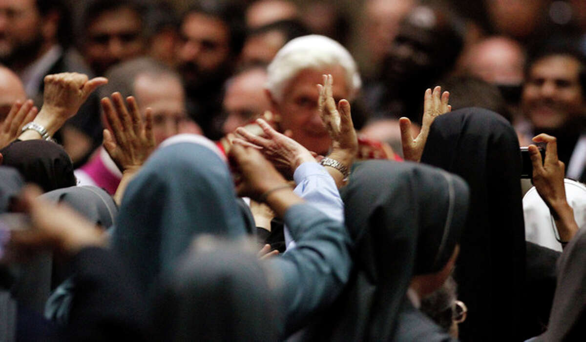 FILE - In this June 2, 2012, file photo, Pope Benedict XVI is greeted by nuns during a meeting with priests and religious at the Duomo gothic cathedral, in Milan, Italy. Benedict has been trying to restore Catholic traditions he believes were lost 50 years ago in the modernizing reforms of the Second Vatican Council. As he presses for a more conservative Catholicism, the pope has been vigilant about ensuring that groups and individuals that operate in the name of the church are adhering to core Catholic teaching. The Vatican orthodoxy watchdog, the Congregation for the Doctrine of the Faith, concluded in April that the Leadership Conference of Women Religious had strayed far from authentic doctrine and gave three American bishops the authority to overhaul the organization. The board for the nuns' group responded by calling the Vatican's investigation flawed and its conclusions unsubstantiated. Top executives of the sisters' organization are bringing their concerns to a meeting Tuesday, June 12, in Rome with Vatican officials. (AP Photo/Luca Bruno, File)