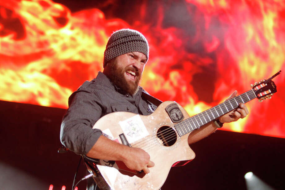 FILE - This June 9, 2012 file photo shows Zac Brown performing during the CMA Fan Fest, in Nashville, Tenn. The Grammy-winning country group will be doing a special on-field performance at Kauffman Stadium in Kansas City ahead of the Home Run Derby on July 9. ( Photo by/Wade Payne/Invision/AP, File) / AP2011