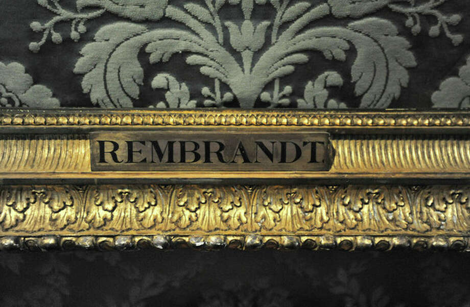"FILE - In this Thursday, March 11, 2010 file photo, a plaque marks the empty frame from which thieves cut Rembrandt's ""The Storm on the Sea of Galilee,"" which remains on display at the Isabella Stewart Gardner Museum in Boston. It is one of 13 works stolen by burglars from the museum in the early hours of March 18, 1990.The FBI said Monday, March 18, 2013, it believes it knows the identities of the thieves who stole the art. Richard DesLauriers, the FBI's special agent in charge in Boston, says the thieves belong to a criminal organization based in New England the mid-Atlantic states. (AP Photo/Josh Reynolds, File) / FR25426 AP"
