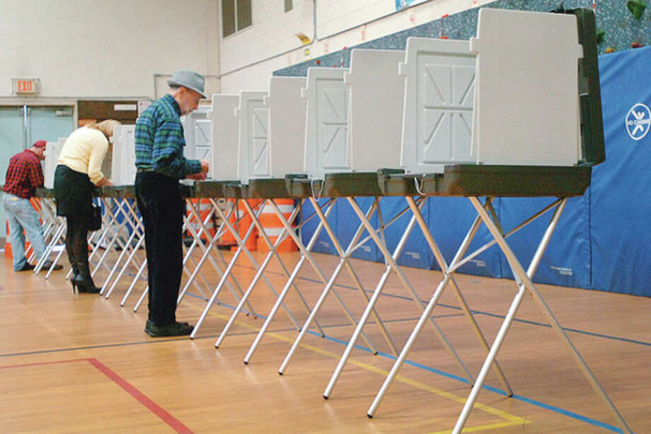 Hour photo / Erik Trautmann Residents vote at Marvin Elementary School in Tuesday's election. / (C)2011, The Hour Newspapers, all rights reserved
