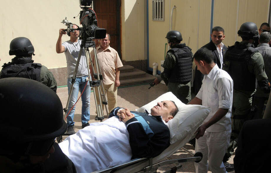 FILE - In this Wednesday, Sept. 7, 2011 file photo, former Egyptian president Hosni Mubarak lies on his bed while being taken to the courtroom for another session of his trial in Cairo, Egypt. Doctors used a defibrillator twice on Hosni Mubarak when they could not find a pulse Monday, the latest health crisis for the ousted Egyptian president since he was sentenced to life and moved to a prison hospital nine days ago, security officials said. (AP Photo/Mohammed al-Law, File) / AP