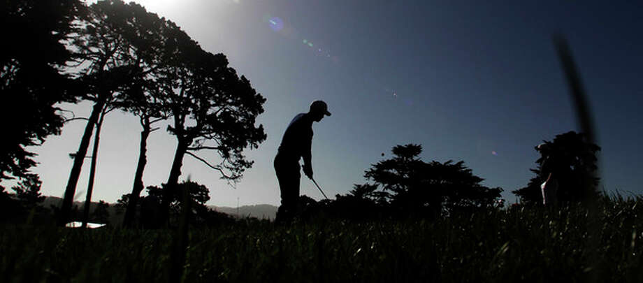 Tiger Woods hits a chip shot on the seventh hole during a practice round for the U.S. Open Championship golf tournament Tuesday, June 12, 2012, at The Olympic Club in San Francisco. (AP Photo/Charlie Riedel) / AP
