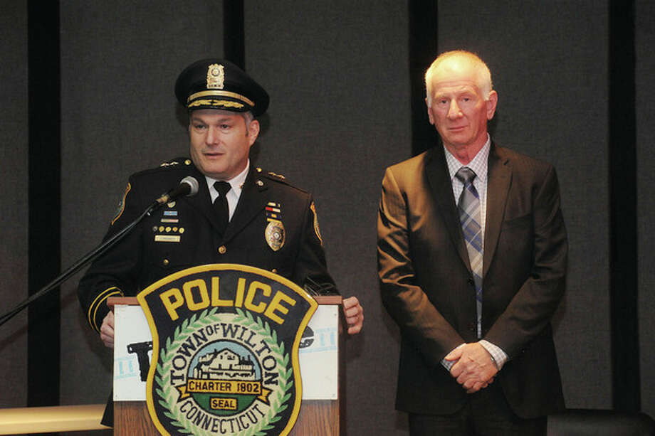 Hour photo/Matthew VinciWilton Police Chief Michael Lombardo gives Sgt. Tom Tunney the Officer of the Year award. Tunney also received the Medal of Honor at the Wilton Police Department awards ceremony on Monday at the Trackside Teen Center.