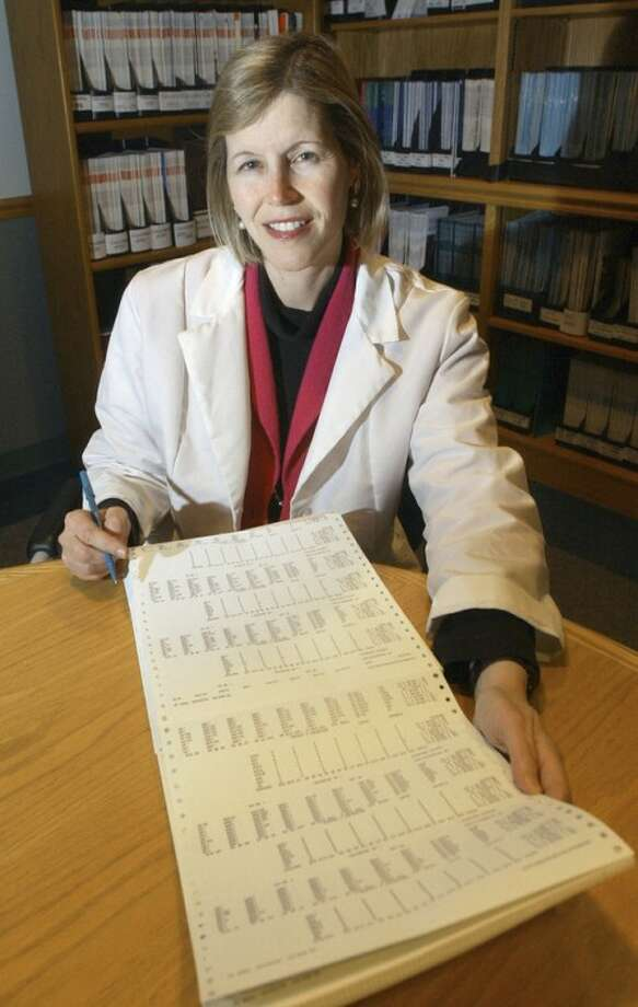 FILE - In this Dec. 12, 2002 file photo, Dr. JoAnn Manson poses for a photo in Boston. Manson, chief of preventive medicine at Harvard's Brigham and Women's Hospital, says women employees are less likely than men to ask her for pay raises, a phenomenon she says may explain results of a new study showing women doctor-researchers get paid substantially less than their male counterparts. The study involving 800 doctors nationwide appears Wednesday, June 12, 2012, in Journal of the American Medical Association. (AP Photo/Elise Amendola, File)