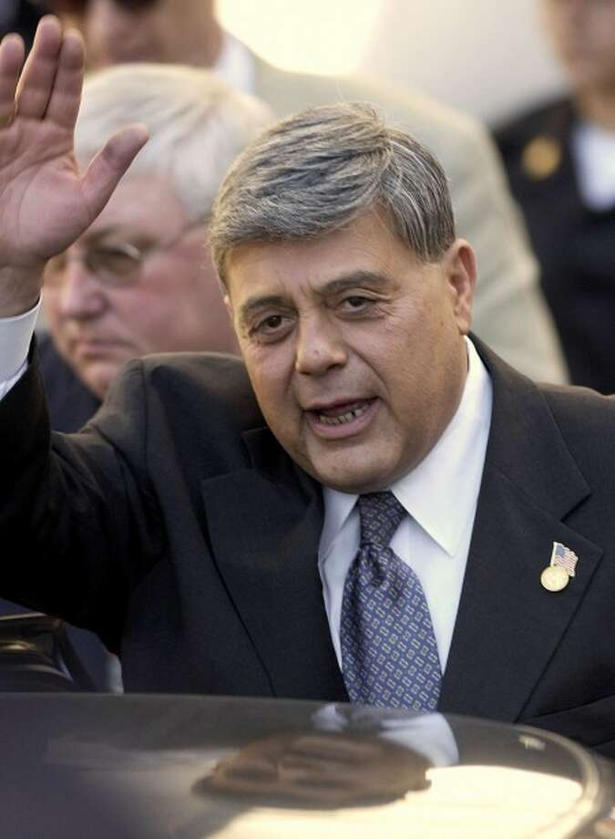 "FILE - In this Sept. 6, 2002 file photo, former Providence, R.I., Mayor Vincent ""Buddy"" Cianci waves to supporters in Providence, after being sentenced to federal prison for his conviction on racketeering conspiracy charges. Cianci is the ultimate political phoenix: a rising star in the national Republican Party cast out of the mayor''s office twice _ once amid a felony conviction and years later a federal corruption probe _ only to emerge from years in prison and return to prominence as a radio talk show host each time. (AP Photo/Steven Senne, File)"