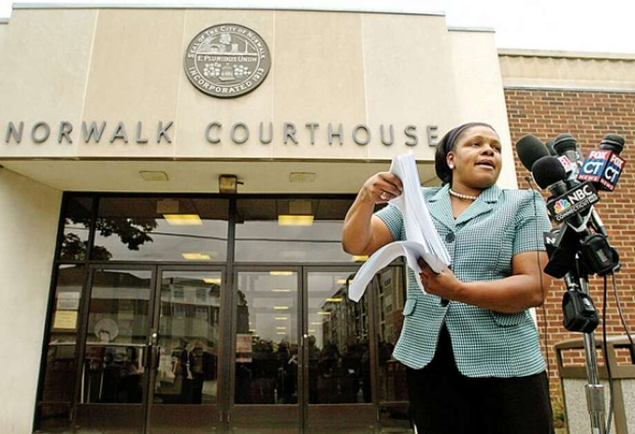 Gwen Samuels, chair of the Connecticut Parents Union, holds a press conference Wednesday morning to announce the presentation of a petition to prosecutors for dismissal of the case of larceny against Tanya McDowell who was charged for enrolling her son in the Norwalk Public Schools while living in Bridgeport. Hour photo / Erik Trautmann