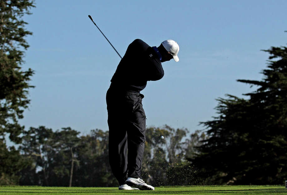 Tiger Woods hits a drive on the fourth hole during a practice round for the U.S. Open Championship golf tournament Tuesday, June 12, 2012, in San Francisco. (AP Photo/Charlie Riedel) / AP