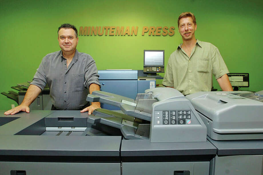 Hour photo/Erik Trautmann Co-owners of Minuteman Press, Joe Brenneis and Greg Duffey, at their new location on Main Street in Norwalk. / (C)2011, The Hour Newspapers, all rights reserved