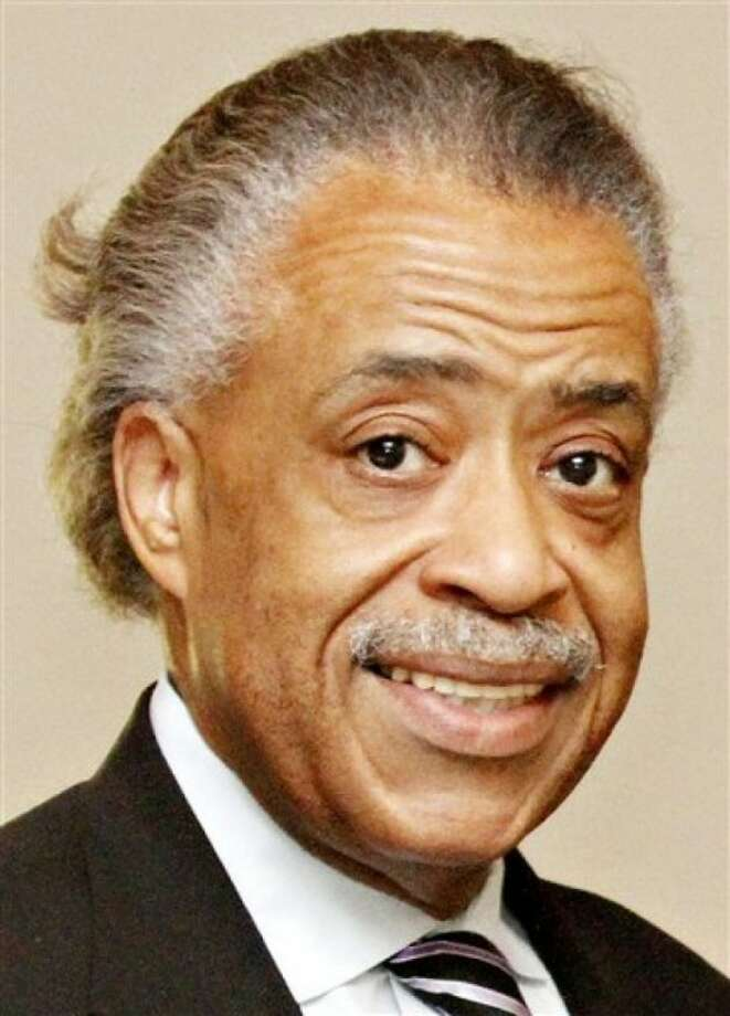 The Rev. Al Sharpton poses for a photo at following a news conference at Mount Carmel Baptist Church in Waterloo, Iowa on Monday, May 23, 2011. (AP Photo/Waterloo Courier, Dawn J. Saget)