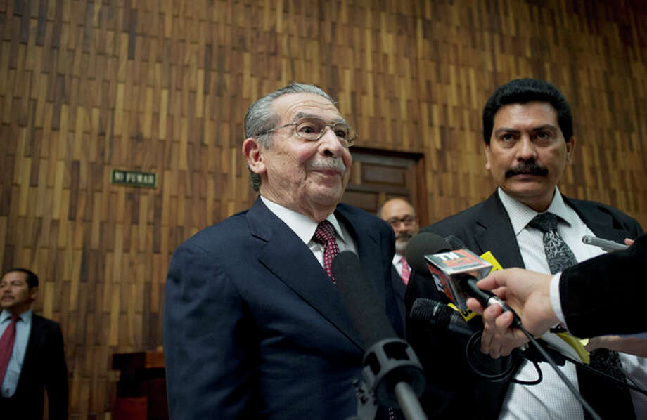 Guatemala's former dictator Jose Efrain Rios Montt speaks to the press as he arrives to court to stand trial on genocide charges in Guatemala City, Tuesday, March 19, 2013. Prosecutors hope to painstakingly prove through a detailed recreation of the military chain of command that Gen. Efrain Rios Montt must have had knowledge of the massacres of Mayan Indians and others in the Guatemalan highlands during one of the bloodiest phases of the country's long civil war. Because he held absolute power over the U.S.-backed military government, his failure to stop the slaughter is proof of his guilt, prosecutors and lawyers for victims say. (AP Photo/Moises Castillo) / AP