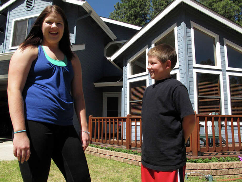In this photo taken Thursday, June 7, 2012, Colleen Knaggs, 18, talks about her fruitless efforts to find a summer job, from her home in Flagstaff, Ariz. Instead, Knaggs will be babysitting her younger brother, Matthew Knaggs, 10, right. Once a rite of passage to adulthood, summer jobs for teens are disappearing. Fewer than 3 in 10 American teenagers now hold such positions as running cash registers, mowing lawns or busing tables in the months from June to August. The decline has been particularly sharp since 2000, with employment for the 16-19-year olds falling to the lowest level since World War II. (AP Photo/Felicia Fonseca) / AP