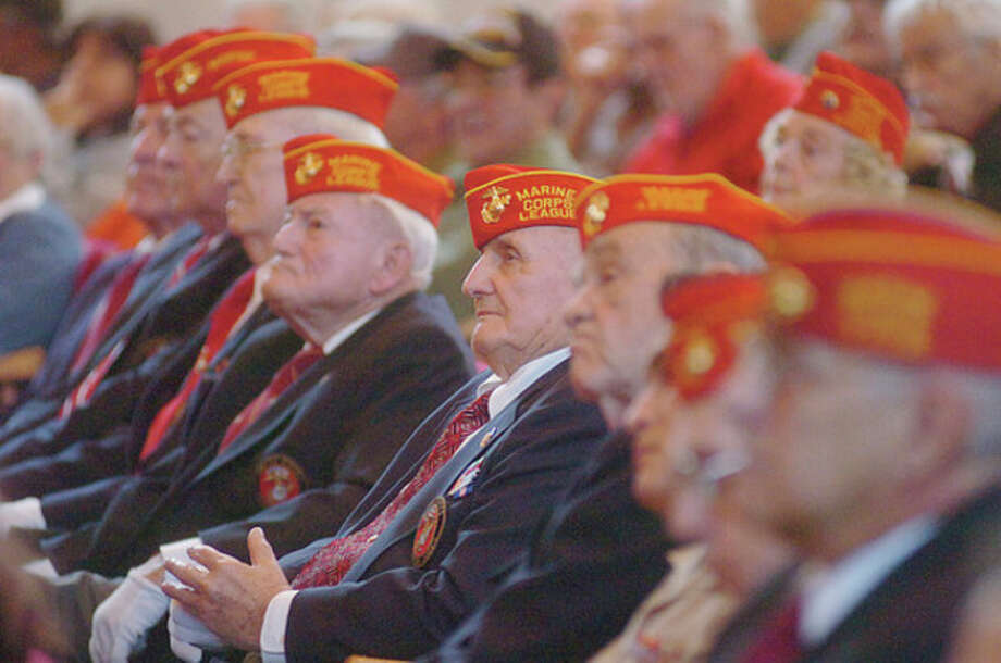 The Marine Corps League's Mahackemo Detachment watches the city's annual Veteran's Day program Friday. Hour photo / Erik Trautmann / (C)2011, The Hour Newspapers, all rights reserved