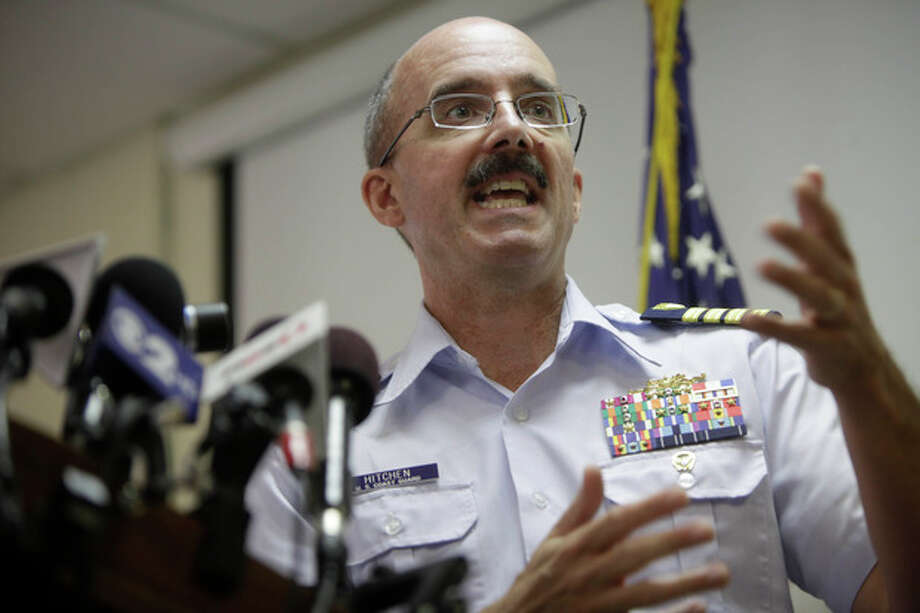 Deputy Commander of Coast Guard Sector New York Capt. Gregory Hitchen speaks during a news conference in New York, Tuesday, June 12, 2012. The Coast Guard says a reported explosion on a motor yacht off central New Jersey likely was a hoax and that an extensive search and rescue operation cost hundreds of thousands of dollars. (AP Photo/Seth Wenig) / AP