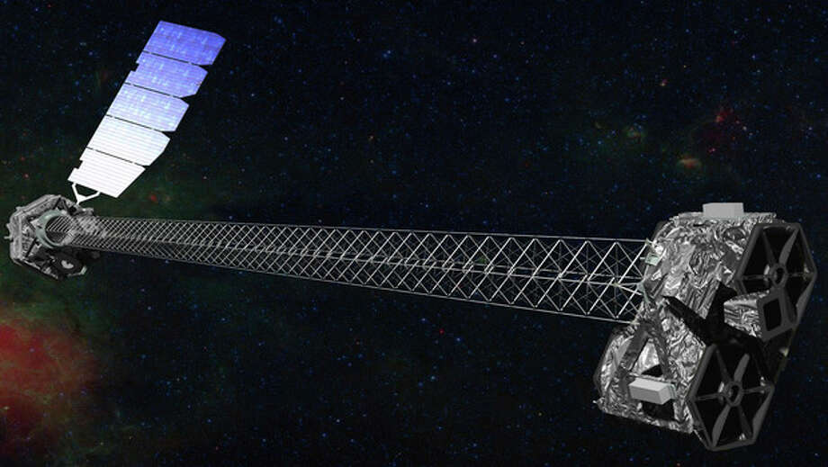 This image provided by NASA shows an artist rendering of the space agency's latest X-ray telescope. NuStar is set to launch on a two-year mission on Wednesday June 13,2012 from the Kwajalein Atoll in the Pacific to study black holes and other celestial objects. (AP Photo/NASA) / NASA