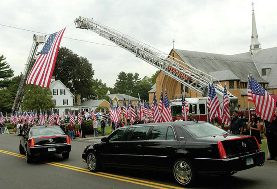 The funeral procession for Navy Petty Officer Brian Bill enters St Celia's Church in Stamford Friday. / (C)2011, The Hour Newspapers, all rights reserved