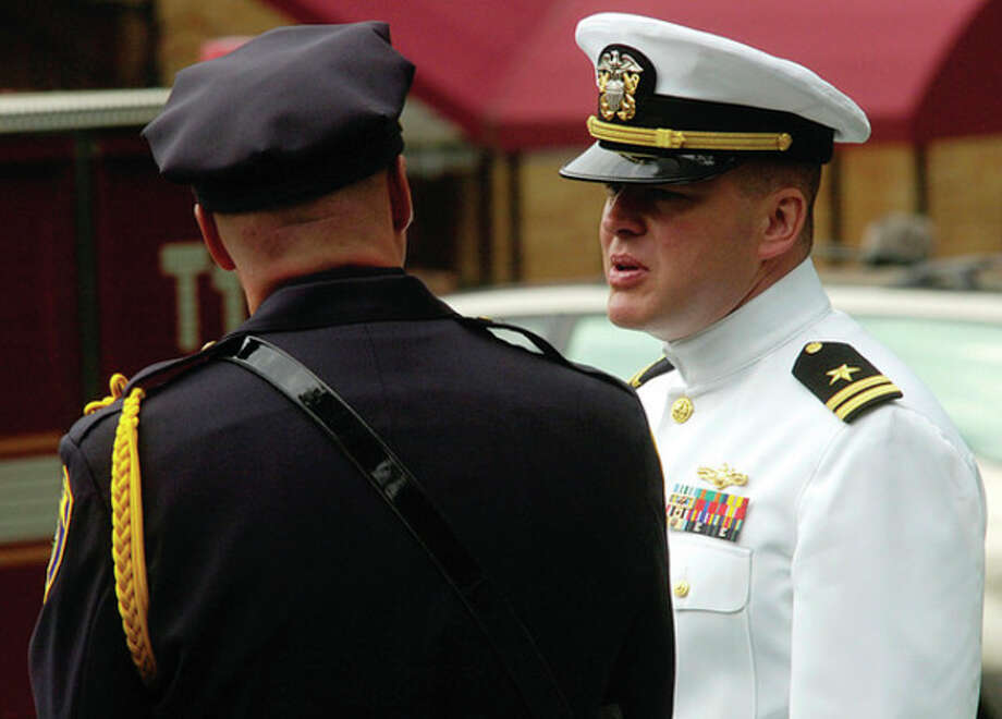 Police and military attend the funeral service for Navy Petty Officer Brian Bill at St Celia Church in Stamford Friday. / (C)2011, The Hour Newspapers, all rights reserved