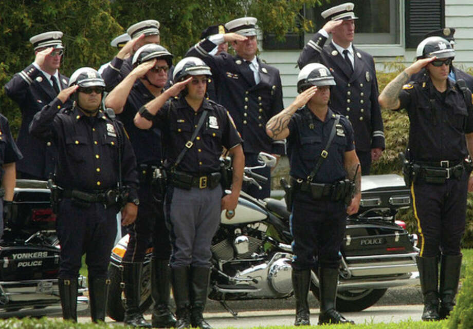 @White=[C] Hour photos / Erik Trautmann Above, Stamford police salute the procession during the funeral service for Navy Chief Petty Officer Brian Bill at St. Cecelia Church Friday. Right, Stamford motorcycle police lead the funeral procession. Top right, Patriot Guard Riders bear flags during the funeral service. / (C)2011, The Hour Newspapers, all rights reserved