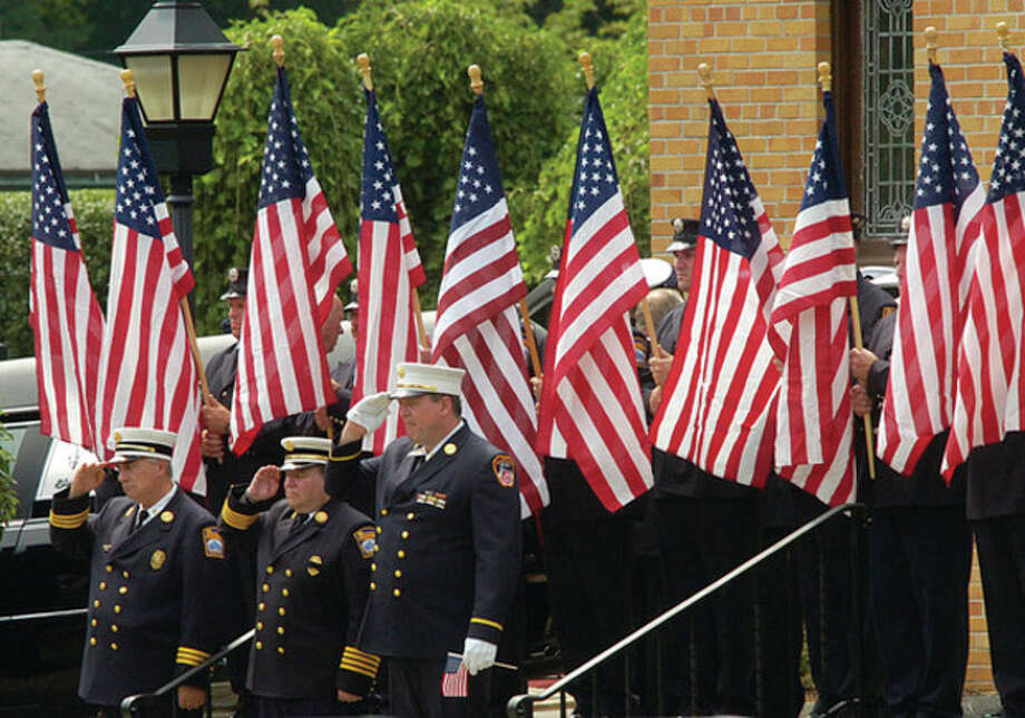 Stamford firefighters attend the funeral service for Navy Chief Petty Officer Brian Bill during the funeral service for the SEAL at St. Cecelia Church Friday. / (C)2011, The Hour Newspapers, all rights reserved