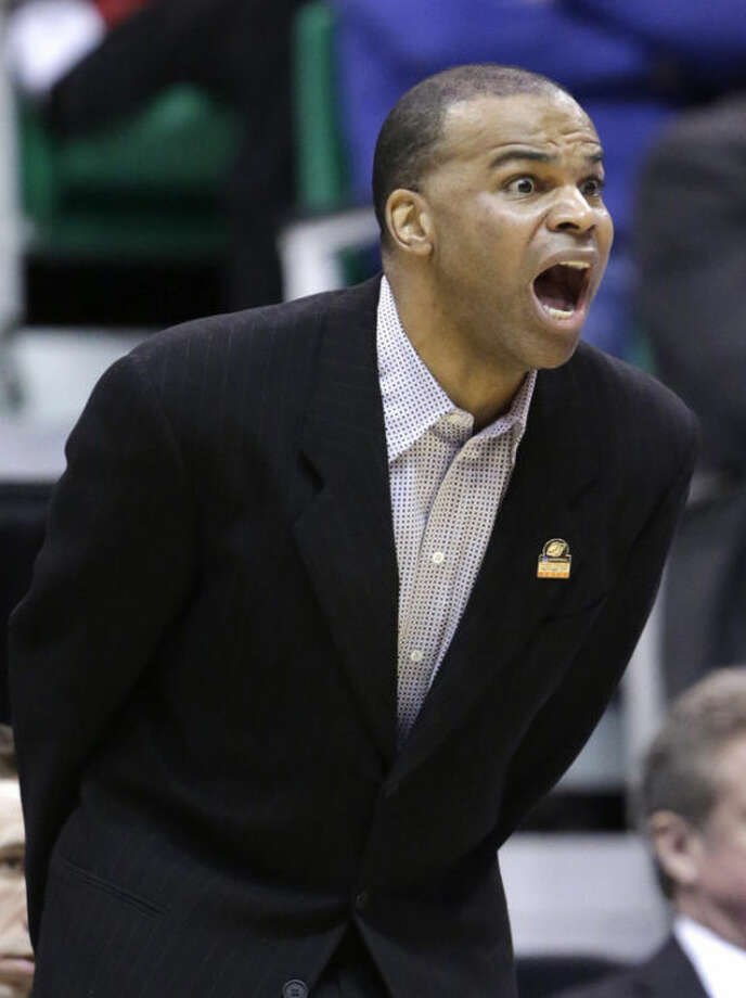 Harvard coach Tommy Amaker shouts to his team in the first half during a third-round game against Arizona in the NCAA men's college basketball tournament in Salt Lake City on Saturday, March 23, 2013. (AP Photo/Rick Bowmer)
