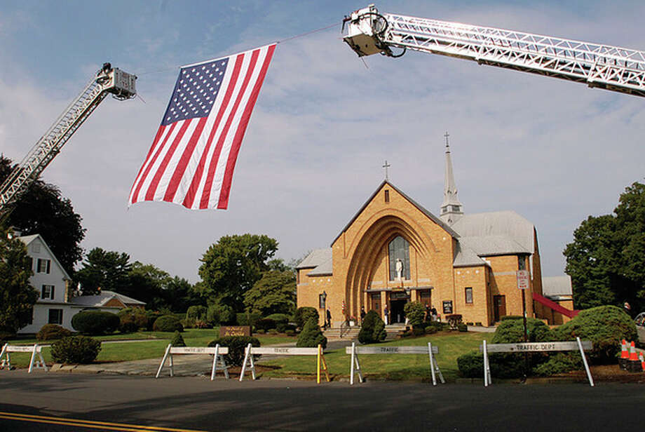 St Celia in Stamford prepares for the funeral service of Navy Chief Petty Officer Brian Bill Friday. / (C)2011, The Hour Newspapers, all rights reserved