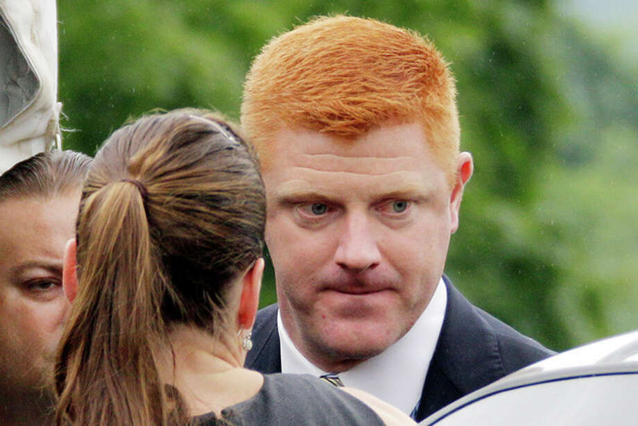 Penn State University assistant football coach Mike McQueary arrives at the Centre County Courthouse to testify in the child sexual abuse trial of former Penn State University assistant football coach Jerry Sandusky in Bellefonte, Pa., Tuesday, June 12, 2012. Sandusky is charged with 52 counts of child sexual abuse involving 10 boys over a period of 15 years. (AP Photo/Gene J. Puskar) / AP