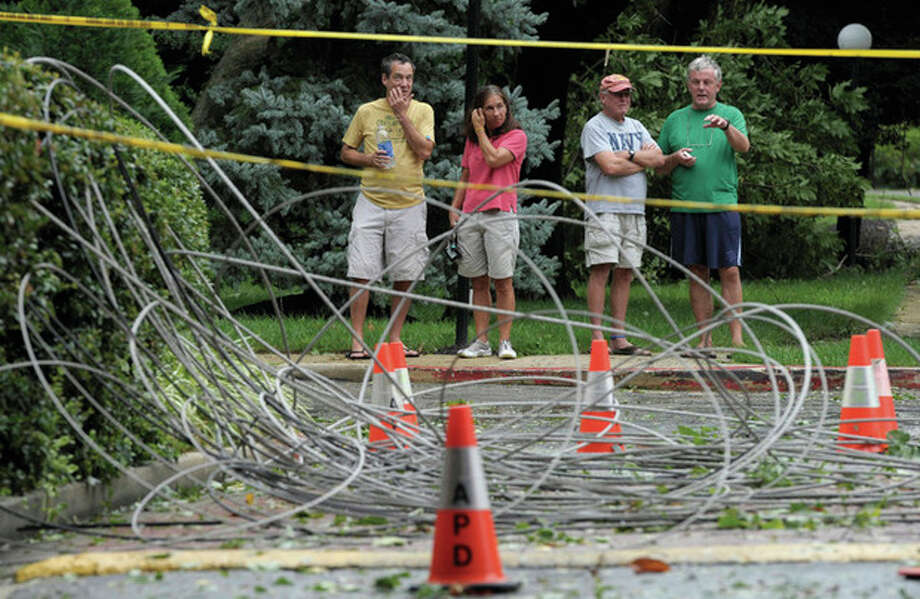 AP photo / Susan Walsh, File In this file photo taken Aug. 28, residents of Annapolis, Md., look at downed power lines after Hurricane Irene. / Copyright 2011 The Associated Press. All rights reserved. This material may not be published, broadcast, rewritten or redistributed.