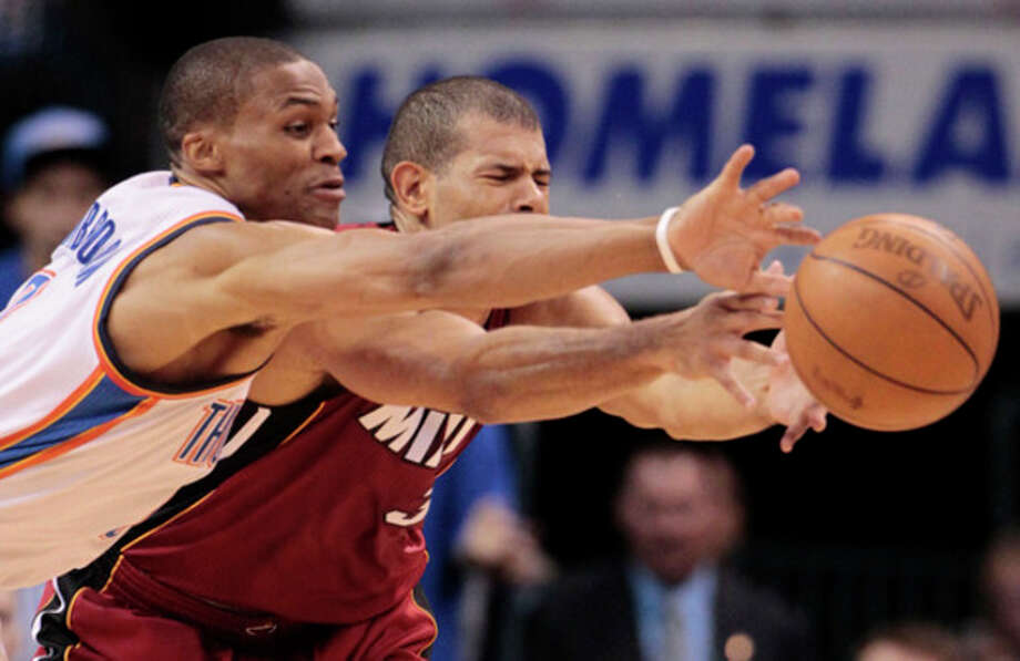 Oklahoma City Thunder point guard Russell Westbrook and Miami Heat small forward Shane Battier go after a loose ball during the first half at Game 1 of the NBA finals basketball series, Tuesday, June 12, 2012, in Oklahoma City. (AP Photo/Jeff Roberson) / AP
