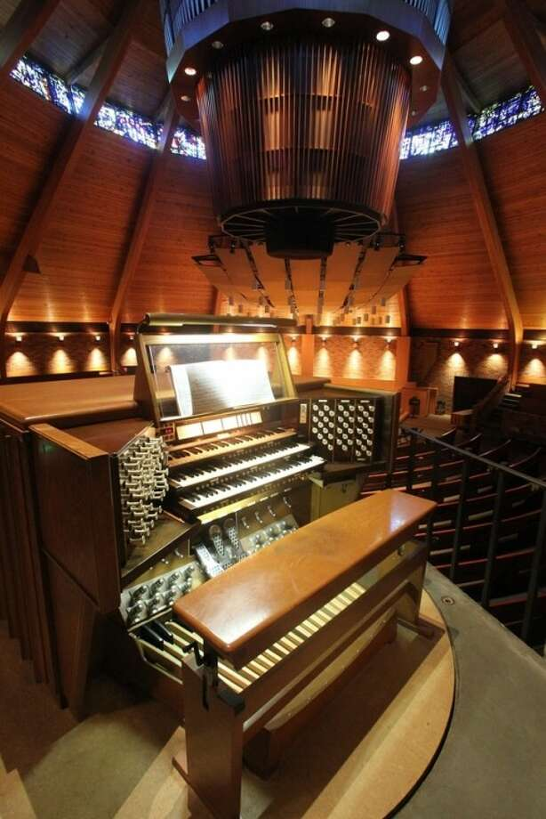 The circular pipe organ is shown at the Agnes Flanagan Chapel Tuesday, June 12, 2012, on the campus of Lewis & Clark College, in Portland, Ore. The Agnes Flanagan Chapel is a 16-sided architectural marvel that seats 650 under stained glass windows depicting the book of Genesis. In the early 1970s, it was also a big, conical quandary. Chapels aren't really chapels unless they have an organ, and the newly-minted structure at Portland's Lewis & Clark College was in need. (AP Photo/Rick Bowmer)