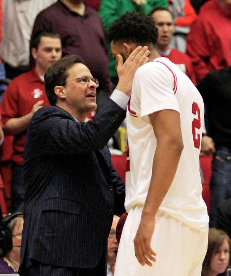 Indiana head coach Tom Crean thanks forward Christian Watford (2) after they defeated Temple 58-52 in a third-round game of the NCAA college basketball tournament, Sunday, March 24, 2013, in Dayton, Ohio. (AP Photo/Skip Peterson) / FR23879 AP