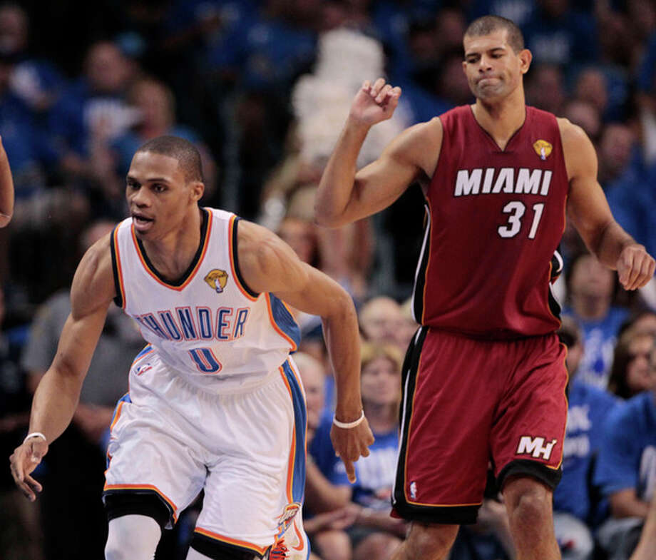 Oklahoma City Thunder point guard Russell Westbrook goes after a loose ball as Miami Heat small forward Shane Battier backs away during the first half at Game 1 of the NBA finals basketball series, Tuesday, June 12, 2012, in Oklahoma City. (AP Photo/Jeff Roberson) / AP