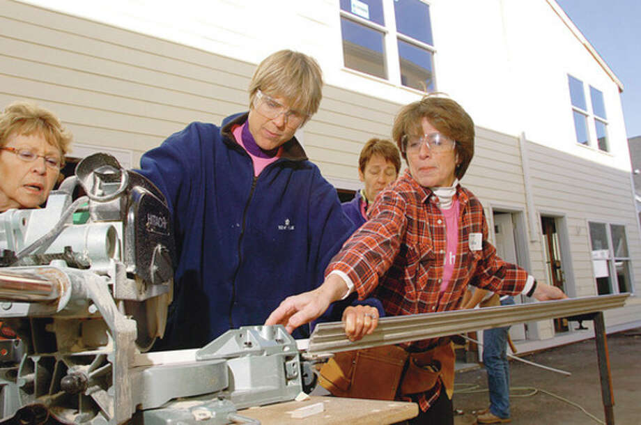 Hour photo / Erik Trautmann Political wives Mary Scott Himes and Cynthia Blumenthal hosted a Women Build workday at 251 West Main St. in Stamford earlier this week with Habitat for Humanity of Coastal Fairfield County. / (C)2011, The Hour Newspapers, all rights reserved