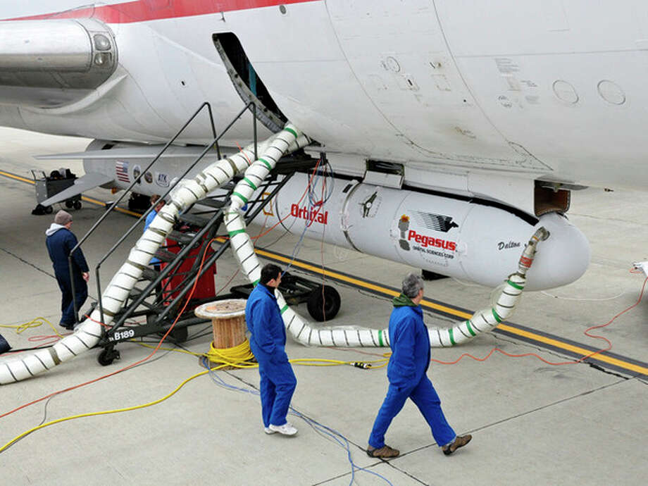 """This undated photo provided by NASA shows the Orbital Sciences Corporation Pegasus XL rocket with the NuSTAR spacecraft after attachment to the L-1011 carrier aircraft known as """"Stargazer."""" The Pegasus will launch NuSTAR into space, Wednesday June 13, 2012 where the high-energy X-ray telescope will conduct a census for black holes, map radioactive material in young supernovae remnants, and study the origins of cosmic rays and extreme physics around collapsed stars. (AP Photo/NASA, Randy Beaudoin) / NASA"""