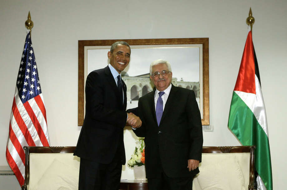 U.S. President Barack Obama and Palestinian President Mahmoud Abbas shake hands during their bilateral meeting at the Muqata Presidential Compound in the West Bank city of Ramallah, Thursday, March 21, 2013. (AP Photo/Pablo Martinez Monsivais) / AP
