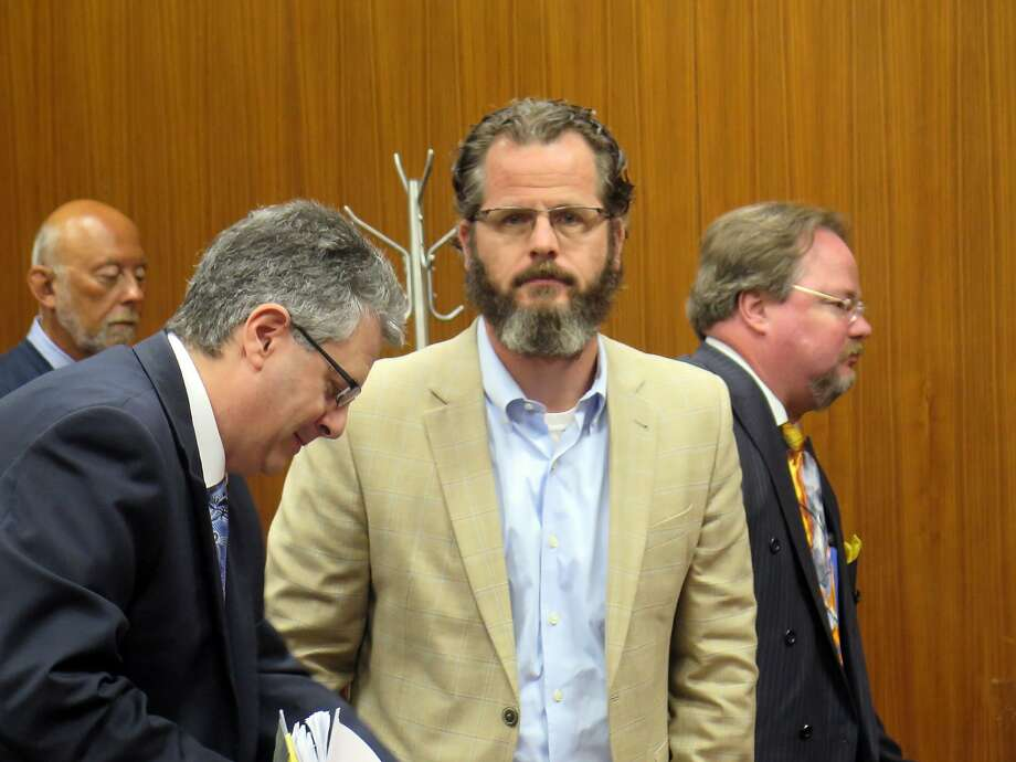 Former Michigan lawmaker Todd Courser (right) reacts after Judge Hugh Clark Jr. allows prosecutors to pursue some of the charges against him. Photo: David Eggert, Associated Press