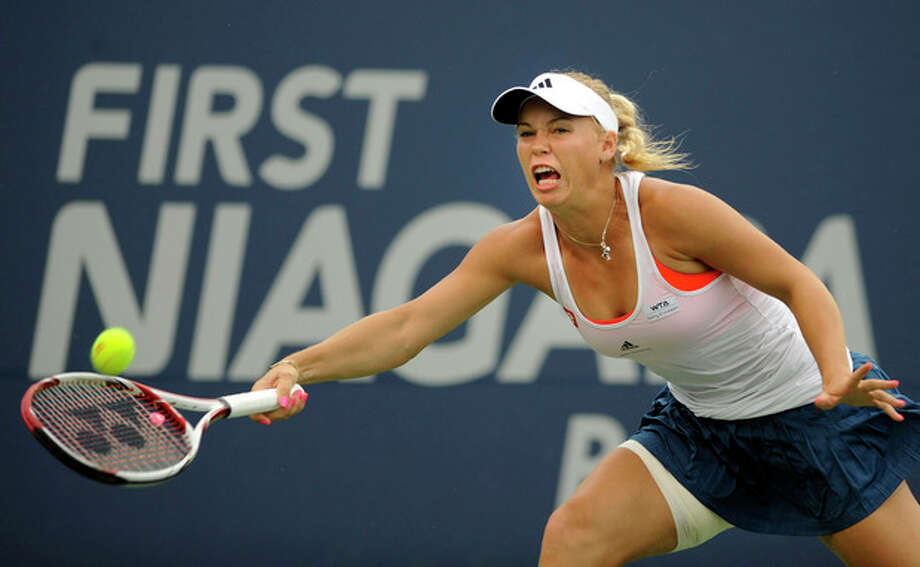 Caroline Wozniacki, of Denmark, hits a forehand during her match against Petra Cetkovska, of the Czech Republic, in the finals of the New Haven Open tennis tournament in New Haven, Conn., on Saturday, Aug. 27, 2011. Play was suspended during the third game of the first set due to rain. (AP Photo/Fred Beckham) / FR153656 AP