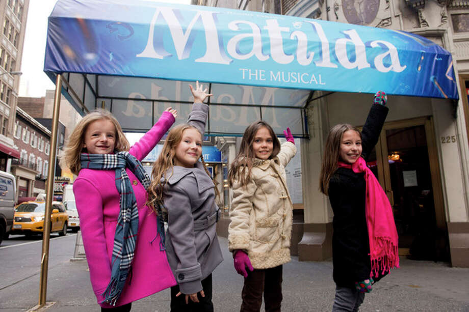"FILE - This Nov. 15, 2012 file photo shows, from left, Milly Shapiro, Sophia Gennusa, Oona Laurence and Bailey Ryon posing for a portrait outside the Shubert Theatre in New York. The four young actresses share the title role in ""Matilda the Musical"" on Broadway. (Photo by Charles Sykes/Invision/AP, file) / Invision"