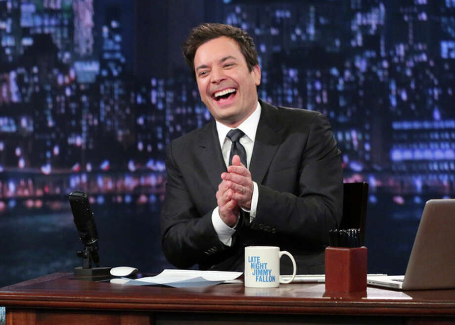 "This Feb. 21, 2013 photo released by NBC shows Jimmy Fallon, host of ""Late Night with Jimmy Fallon,"" on the set in New York. As Jay Leno lobs potshots at ratings-challenged NBC in his ""Tonight Show"" monologues, speculation is swirling the network is taking steps to replace the host with Jimmy Fallon next year and move the show from Burbank to New York. NBC confirmed Wednesday, March 20, it's creating a new studio for Fallon in New York, where he hosts ""Late Night."" But the network did not comment on a report that the digs at its Rockefeller Plaza headquarters may become home to a transplanted, Fallon-hosted ""Tonight Show."" (AP Photo/NBC, Lloyd Bishop) / NBC"