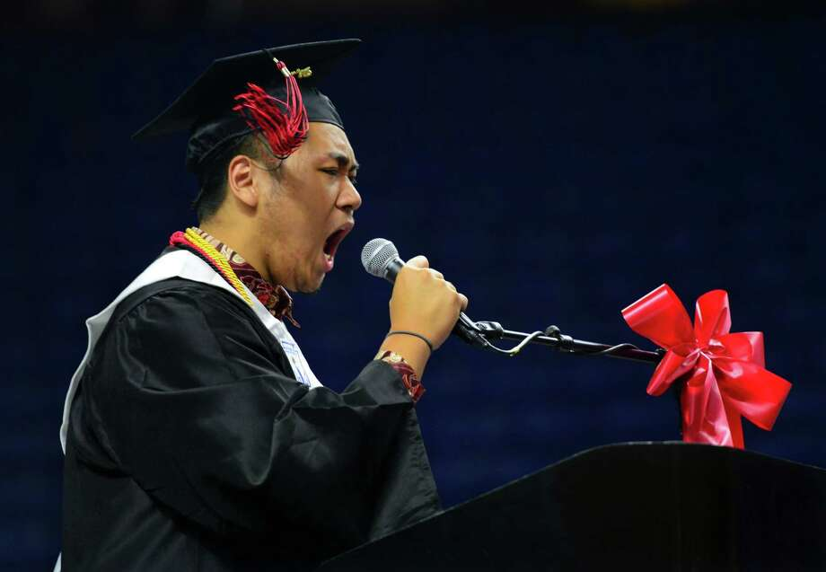 Graduate and Senior Class President Patrick Setiadi lets out a huge cheer before his address during Central High School's Class of 2016 Graduation Exercises at the Webster Bank Arena in Bridgeport, Conn., on Tuesday June 14, 2016. Photo: Christian Abraham, Hearst Connecticut Media / Connecticut Post