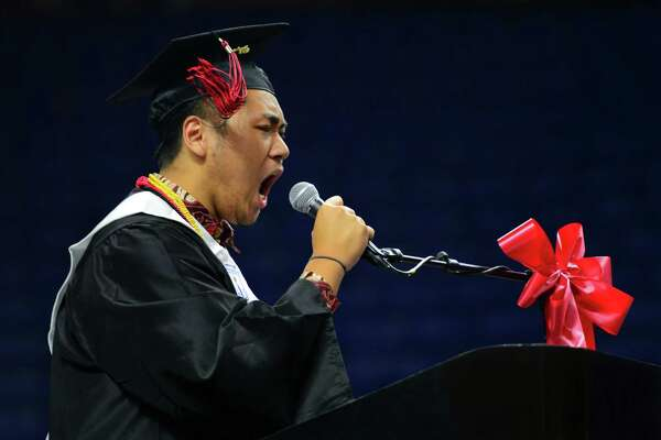 Graduate and Senior Class President Patrick Setiadi lets out a huge cheer before his address during Central High School's Class of 2016 Graduation Exercises at the Webster Bank Arena in Bridgeport, Conn., on Tuesday June 14, 2016.