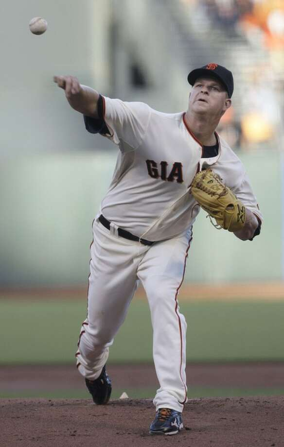 San Francisco Giants pitcher Matt Cain delivers against the Houston Astros during the first inning of a baseball game in San Francisco, Wednesday, June 13, 2012. (AP Photo/Jeff Chiu)