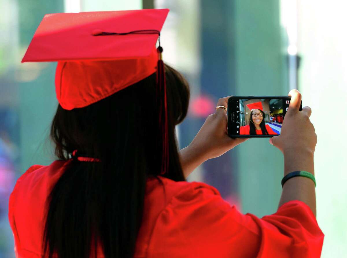 Graduate Brittany Staton snaps a selfie before the start of Central High School's Class of 2016 Graduation Exercises at the Webster Bank Arena in Bridgeport, Conn., on Tuesday June 14, 2016.