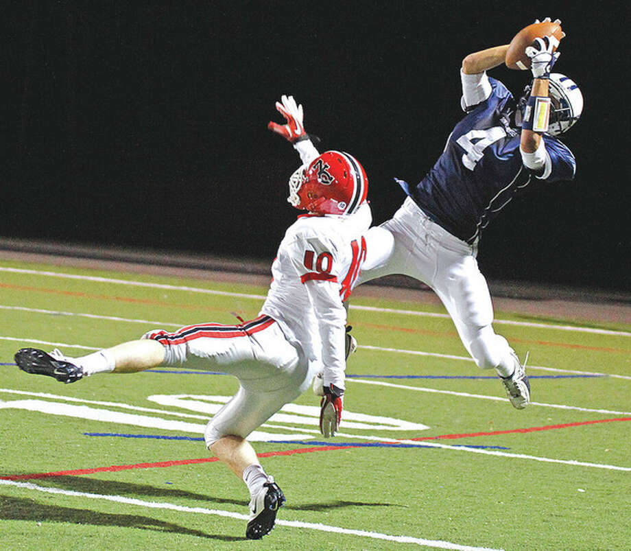 Alex Ward, #4 from Wilton High School, catches a pass during a game against New Canaan on their home field Friday evening. Hour Photo / Danielle Robinson