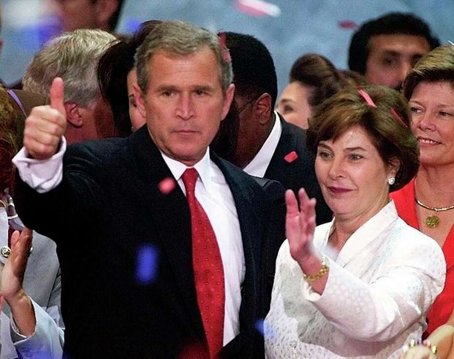 FILE - This Aug. 3, 2000 photo shows then presidential candidate George W. Bush and his wife Laura giving a thumbs up to the crowd after making an acceptance speech at the Republican National Convention in the First Union Center in Philadelphia. A new study shows that contrary to the idea that being president speeds up the aging process, many U.S. commanders in chief have lived longer than their peers. (AP Photo/Ron Edmonds, file) / AP2000