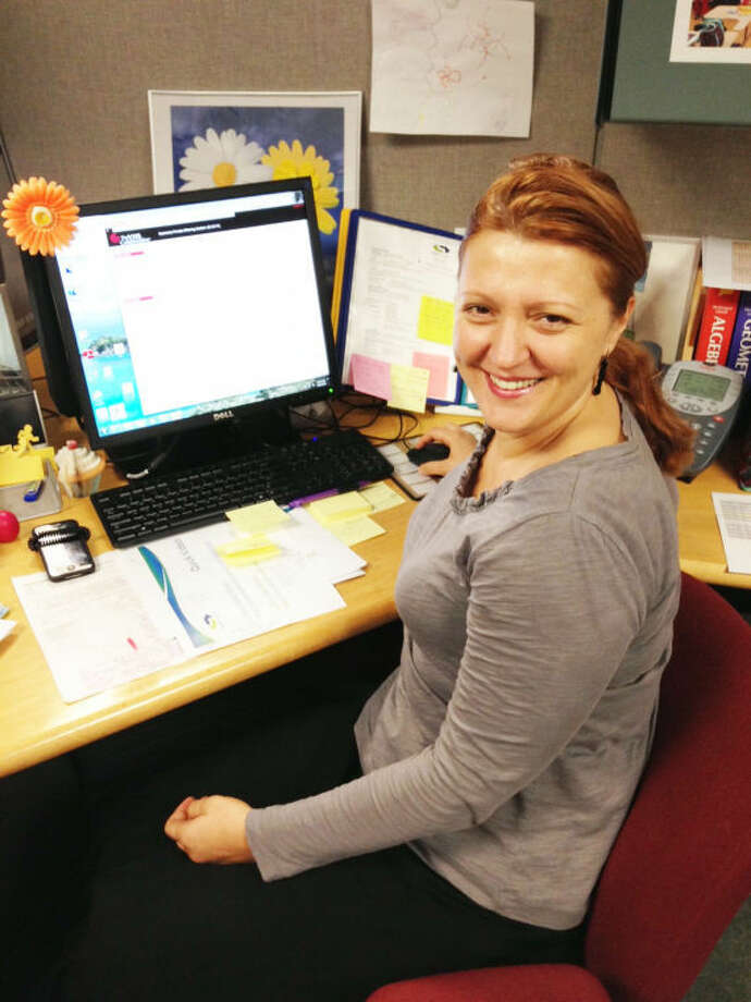 Ljiljana Djinovic sits at her desk at the Stamford Government Center, where she teaches middle school students geometry online.
