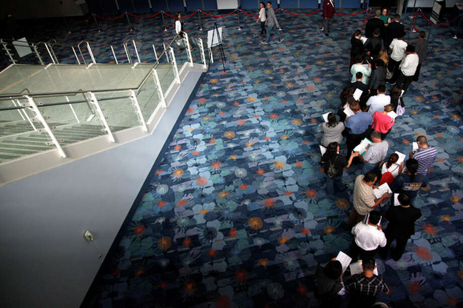 In this June 13, 2012 photo, job seekers wait in line at a job fair expo in Anaheim, Calif. More Americans sought unemployment aid last week, suggesting hiring remains sluggish. The Labor Department said Thursday June 14, 2012 that weekly unemployment benefit applications rose 6,000 to a seasonally adjusted 386,000, an increase from an upwardly revised 380,000 the previous week. (AP Photo/Jae C. Hong) / AP