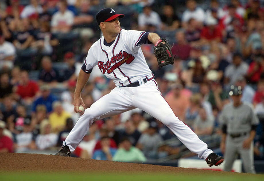 Atlanta Braves pitcher Tim Hudson works the mound against the New York Yankees during the first inning of a baseball game on Wednesday, June 13, 2012, in Atlanta. (AP Photo/John Amis) / FR69715 AP
