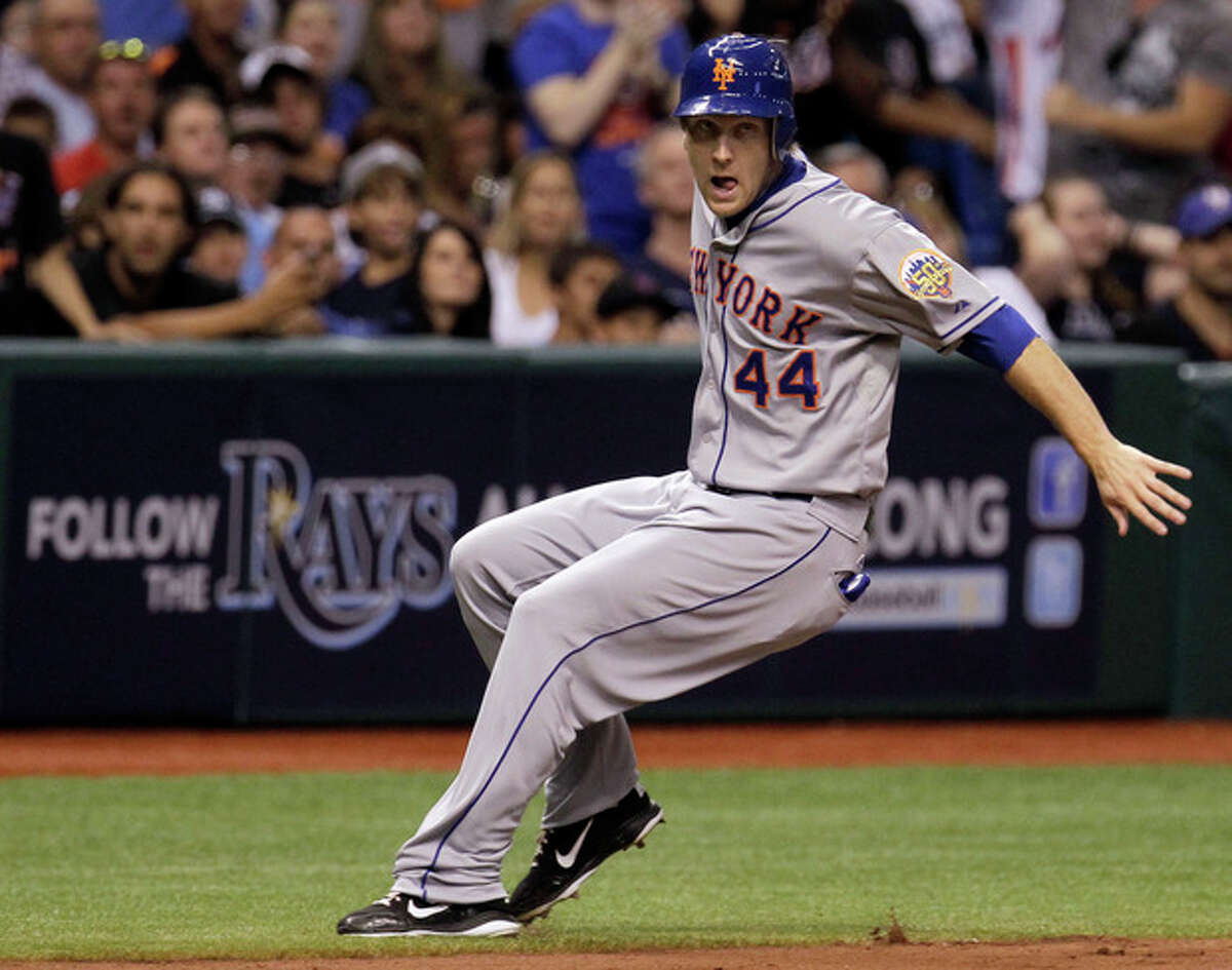 New York Mets' Jason Bay stops as he rounds third base after a sixth-inning RBI double by Vinny Rottino off Tampa Bay Rays starting pitcher David Price during an interleague baseball game Wednesday, June 13, 2012, in St. Petersburg, Fla. (AP Photo/Chris O'Meara)