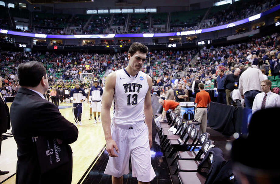 Pittsburgh's Steven Adams (13) walks off the court after his team lost to Wichita State 73-55 in a second-round game in the NCAA college basketball tournament in Salt Lake City Thursday, March 21, 2013. (AP Photo/Rick Bowmer) / AP