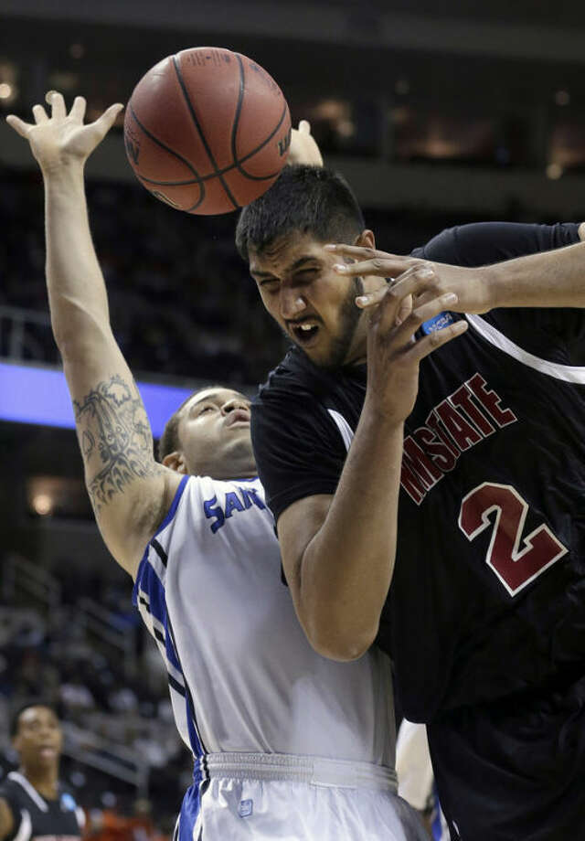 New Mexico State center Sim Bhullar (2) loses a pass in front of Saint Louis forward Grandy Glaze (1) during the first half of a second-round game in the NCAA college basketball tournament in San Jose, Calif., Thursday, March 21, 2013. (AP Photo/Jeff Chiu)